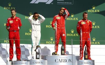 Kimi Raikkonen, coequipero de Vettel, cerró el podio.