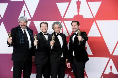 Ian Hunter, J.D. Schwalm, Paul Lambert, y Tristan Myles, ganadores a la categoría Mejor Efectos Especiales por First Man.