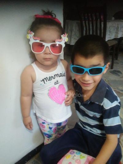 Hermanitos Quiñones Flores