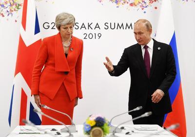 Putin y la primera ministra británica, Theresa May.