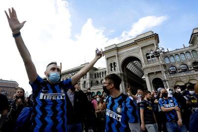 Inter supporters celebrate winning Italian Serie A