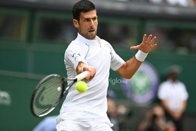 Wimbledon Championships 2021  Wimbledon (United Kingdom), 11/07/2021.- Novak Djokovic of Serbia in action against Matteo Berrettini of Italy during the men's final at the Wimbledon Championships, Wimbledon, Britain 11 July 2021. (Tenis, Italia, Reino Unido) EFE/EPA/NEIL HALL EDITORIAL USE ONLY DEP Tenis WIMBLEDON BRITAIN TENNIS GRAND SLAM 2021 United Kingdom