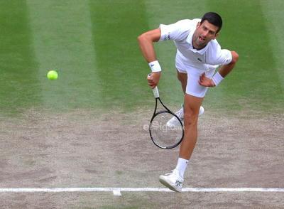 Wimbledon Championships 2021  Wimbledon (United Kingdom), 11/07/2021.- Novak Djokovic of Serbia in action against Matteo Berrettini of Italy during the men's final at the Wimbledon Championships, Wimbledon, Britain 11 July 2021. (Tenis, Italia, Reino Unido) EFE/EPA/VICKIE FLORES EDITORIAL USE ONLY DEP Tenis WIMBLEDON BRITAIN TENNIS GRAND SLAM 2021 United Kingdom