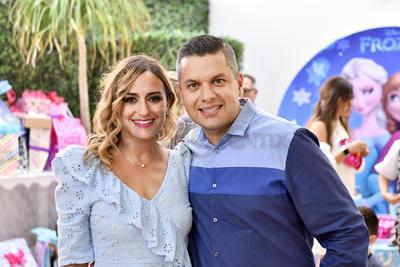 Los papás de las festejadas: Roberto y Eloisa