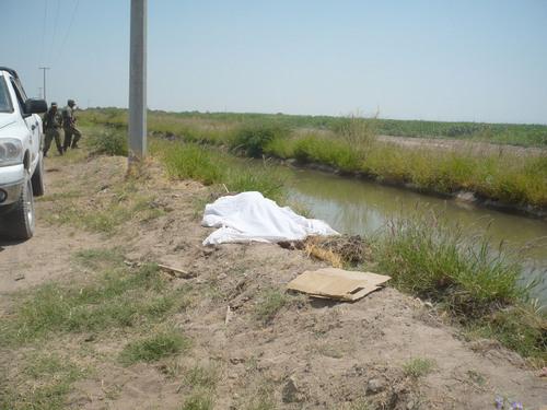 Resultado de imagen para Sacan cadáver de hombre de canal de riego