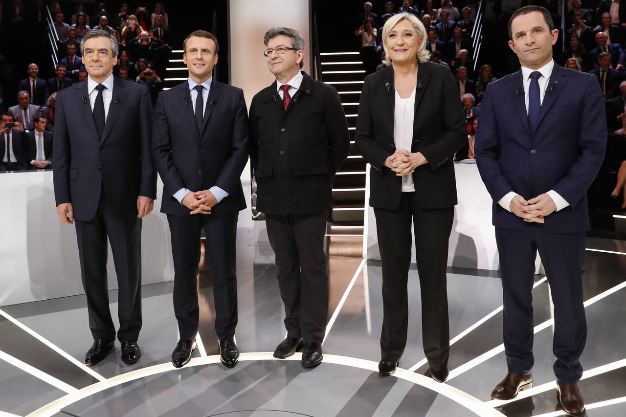 Macron y Le Pen, blanco de los ataques en debate