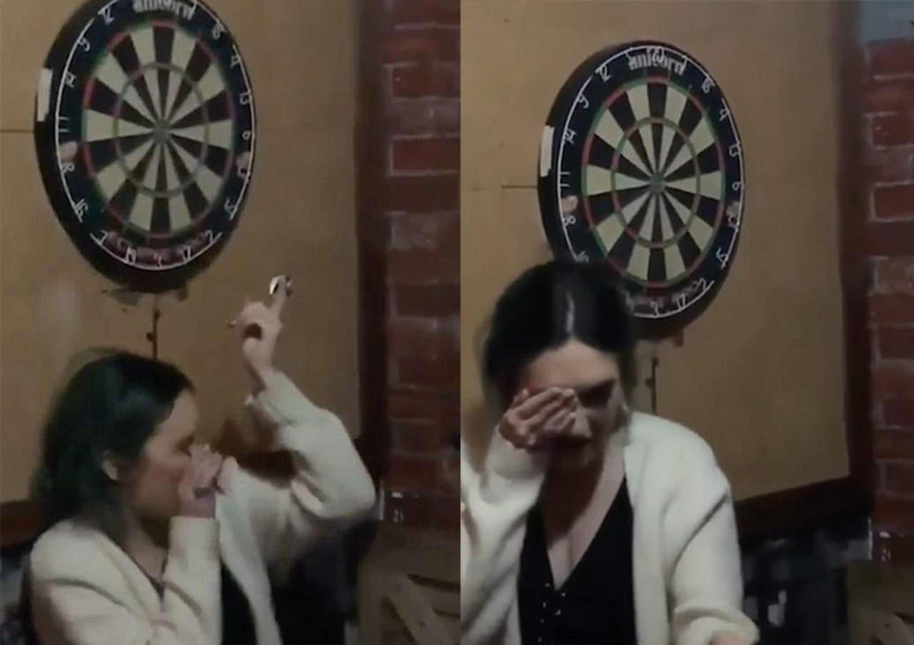 Su novio intenta lanzar dardo sobre su cabeza y le da en el ojo
